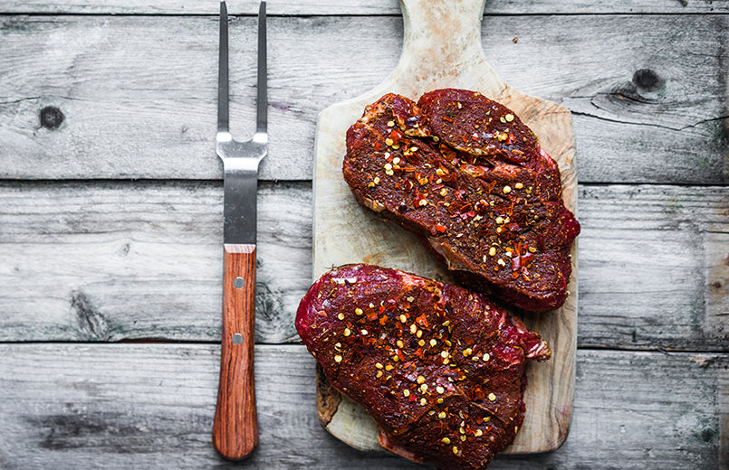 Raw-Meat-rubed-with-paprika-garlic-On-Wooden-Background