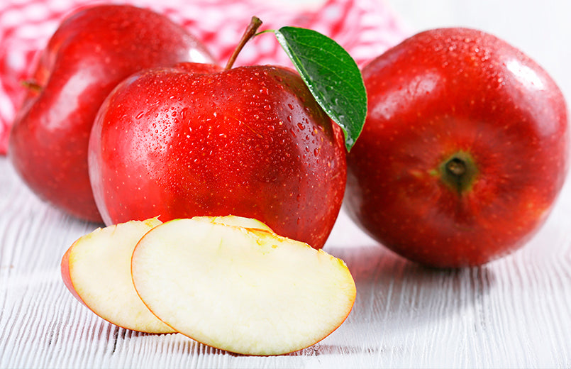 Ripe-red-apples-on-table-close-up