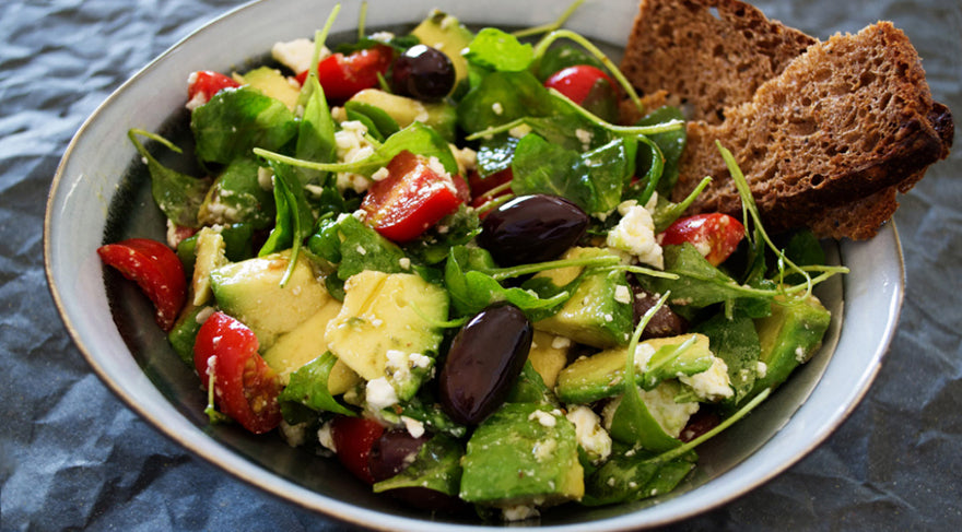 avocado-olives-tomatoes-and-spinnach-salad-with-sprinkled-cheese-and-whole-grain-toast