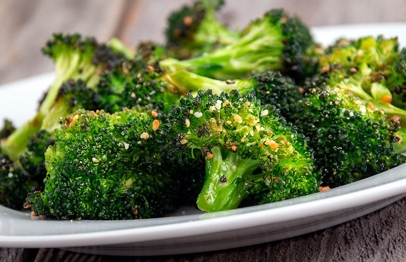 baked-roasted-garlic-parmesan-oil-broccoli-on-wooden-table