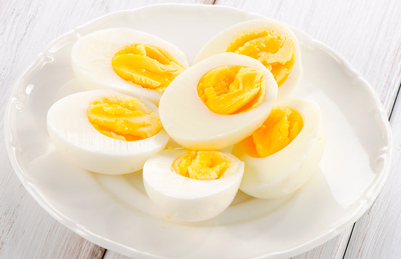 boiled-eggs-on-a-white-plate-on-white-wooden-background