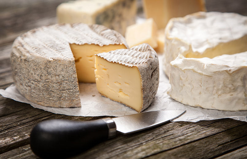 camembert-french-soft-cheese-on-wooden-cutting-board-with-knife