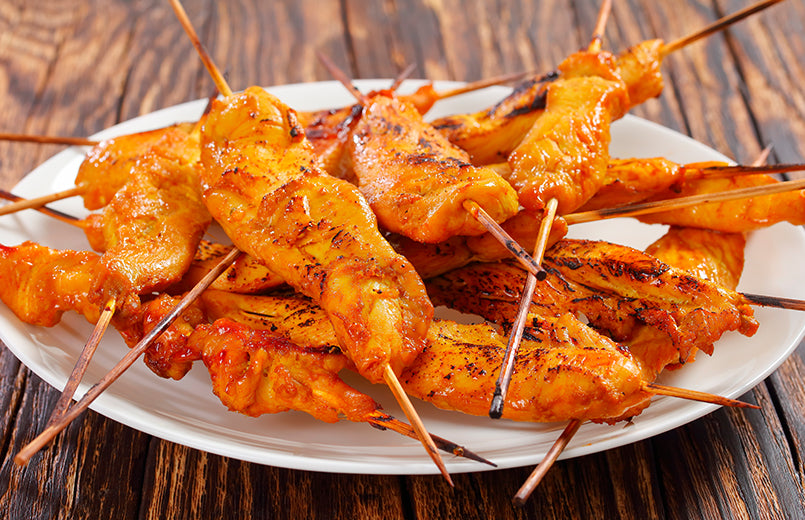 chicken-skewers-on-a-white-plate