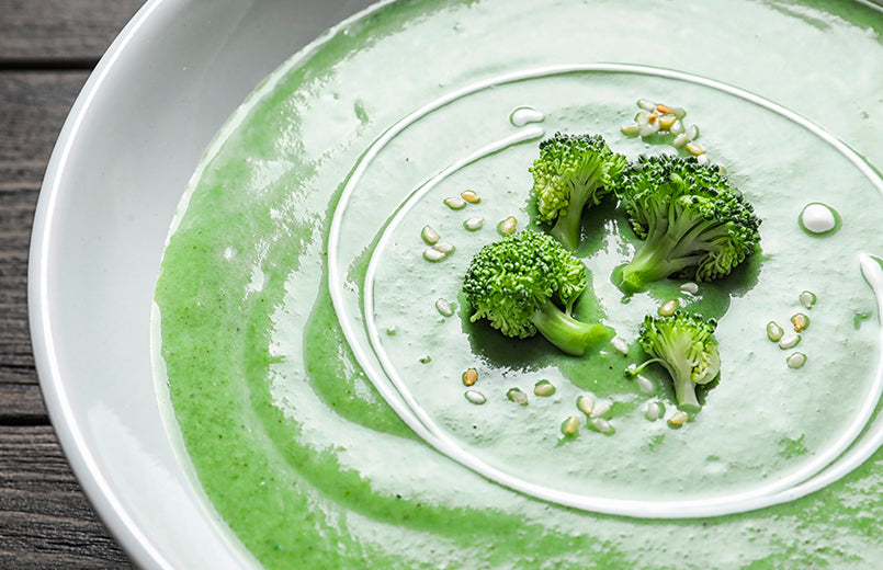 cream-soup-made-of-broccoli-in-a-plate-on-a-wooden-table