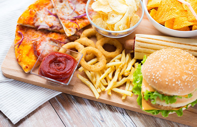 different-fast-food-on-a-wooden-board