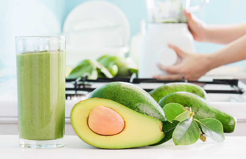 fresh-avocado-smoothie-and-ripe-green-avocados-on-kitchen-table