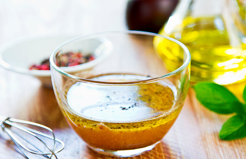 fresh-made-vinaigrette-in-a-glass-bowl-on-a-table-close-view