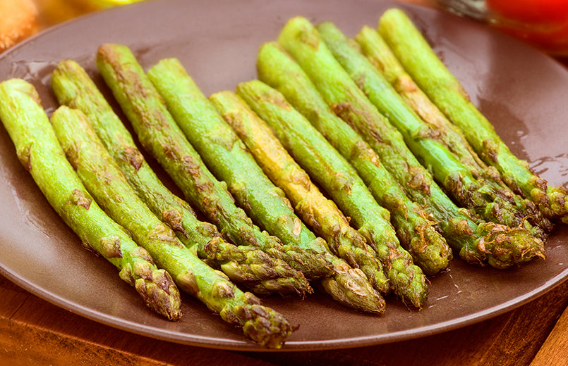 fried-asparagus-on-brown-plate