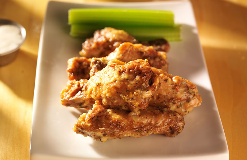 garlic-parmesan-chicken-wings-on-a-white-plate