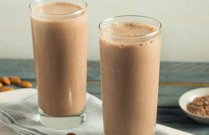 glasses-with-cocoa-almond-milk-smoothie-on-a-table