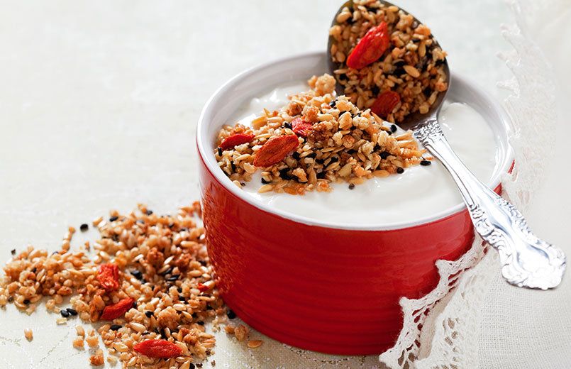 granola-with-chia-seeds-flax-seeds-sesame-seeds-and-goji-berries-in-a-red-bowl-close-view