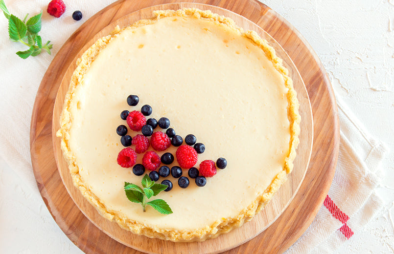 homemade-cream-cheese-pie-with-fresh-berries-and-mint-for-dessert