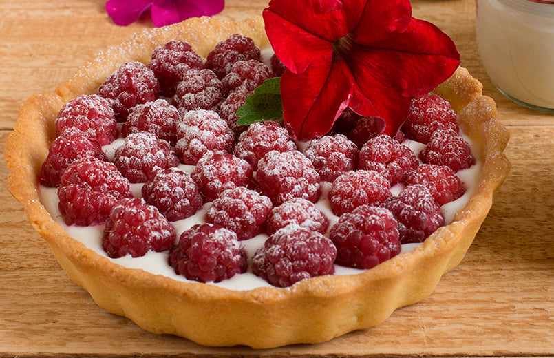 homemade-pie-with-fresh-raspberries-and-mint-on-wooden-table