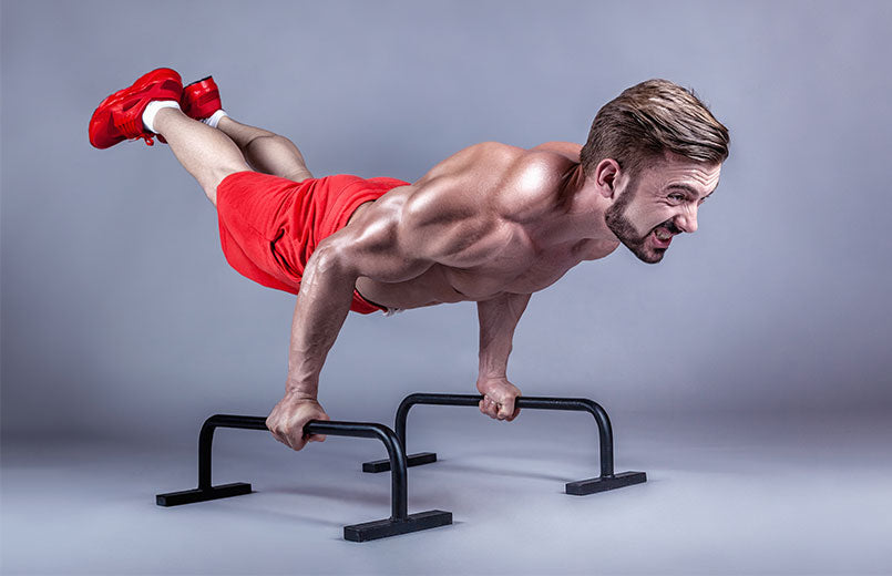 man-doing-calisthenic-moves-extended-legs-planche-push-ups-on-parallel-bars