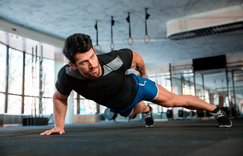 man-doing-push-ups-exercise-with-one-hand-in-fitness-gym
