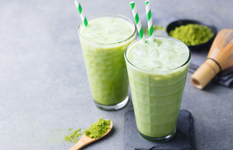 matcha-green-tea-ice-latte-with-matcha-powder-and-bamboo-whisk