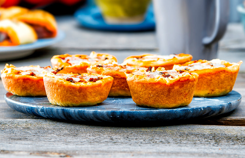 meat-mini-pies-on-a-blue-serving-plate