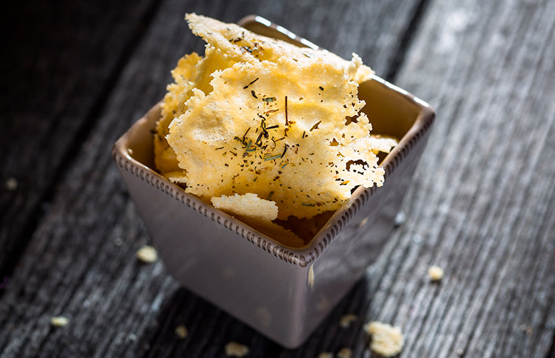 parmesan-chips-on-wood-background