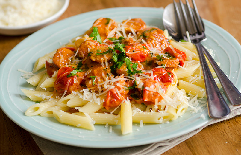 penne-with-chorizo-and-creamy-tomato-sauce-on-white-plate-close-up