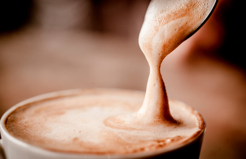pouring-cappuccino-in-a-cup