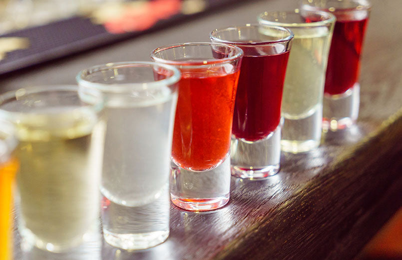 row-of-different-colors-alcohol-shots-on-a-table