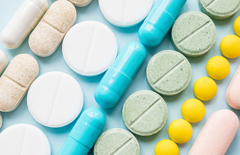 rows-of-different-pills-on-blue-background