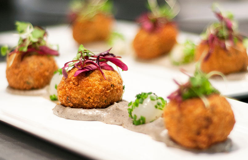 salmon-balls-with-mayonnaise-sauce-on-white-plate-close-up
