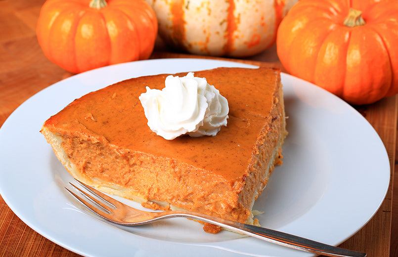slice-of-a-pumpkin-pie-on-wooden-table