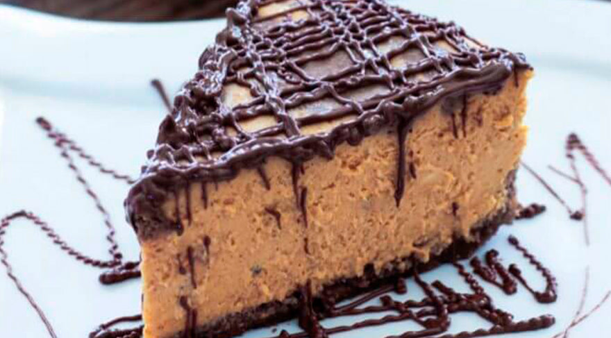 slice-of-chocolate-and-pumpkin-marble-cheesecake-on-a-white-plate