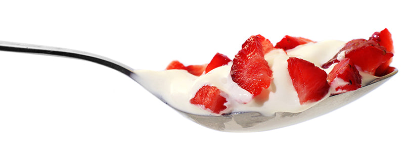 spoon-filled-with-strawberries-and-cream-white-background
