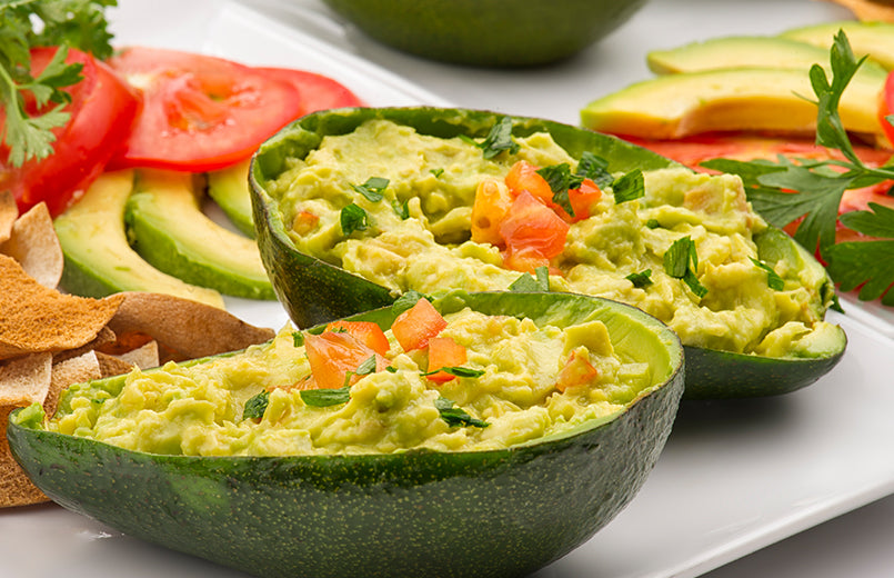 stuffed-avocado-on-white-plates
