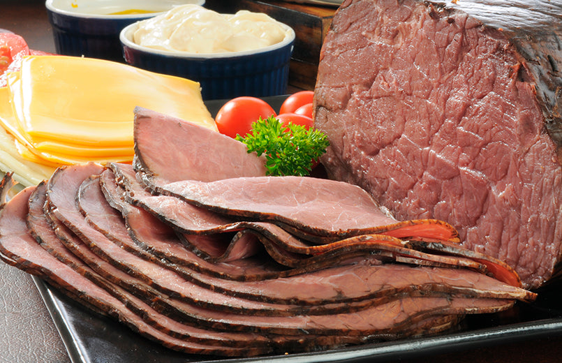 thin-sliced-roast-beef-with-cheeses-on-a-table
