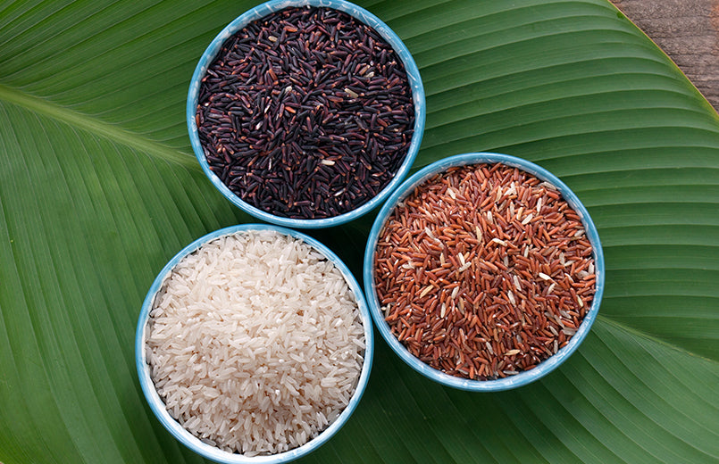 three-types-of-rice-in-bowls-with-a-palm-leaf-as-background