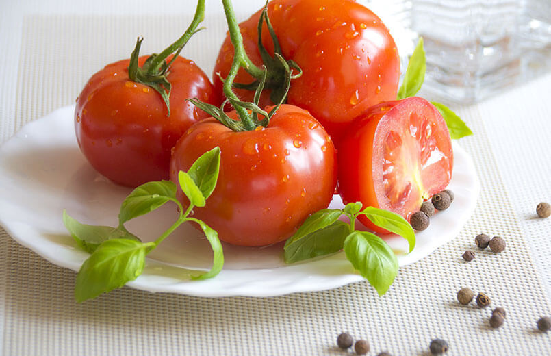 tomatoes-and-basil-on-a-white-plate