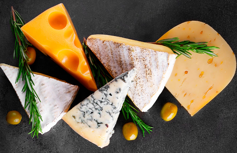 variety-of-soft-and-hard-cheeses-on-a-black-background
