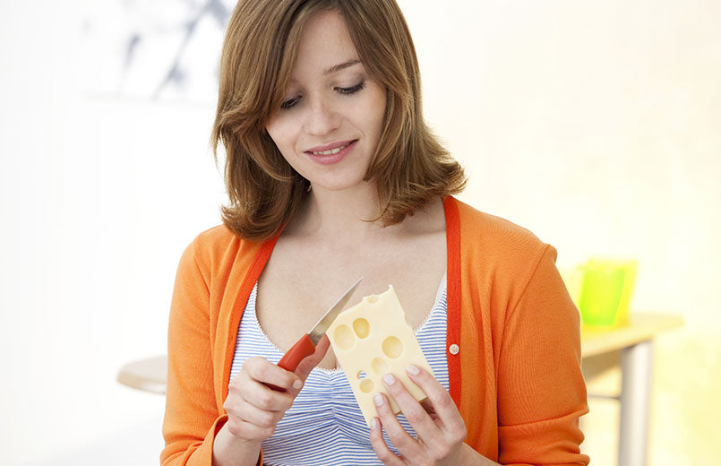 woman-cutting-with-knife-a-piece-of-cheese-preparing-to-eat