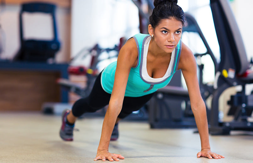 woman-doing-push-ups-at-the-gym