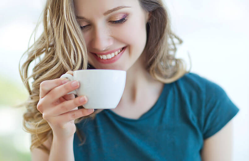 woman-drinking-from-a-cup-of-coffee-or-tea