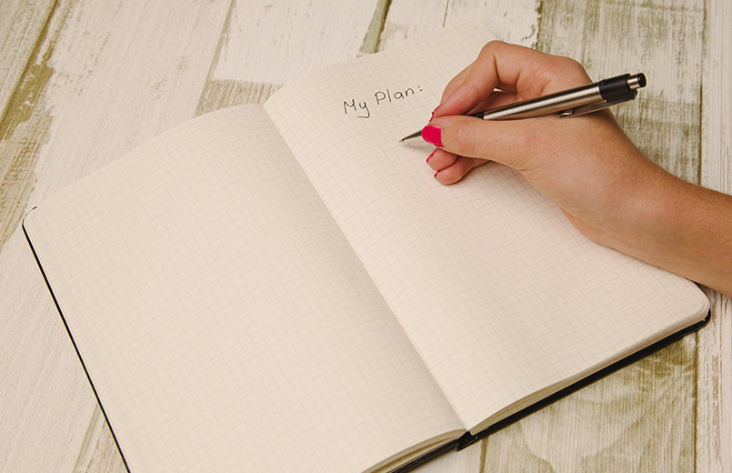woman-hand-write-in-a-notebook