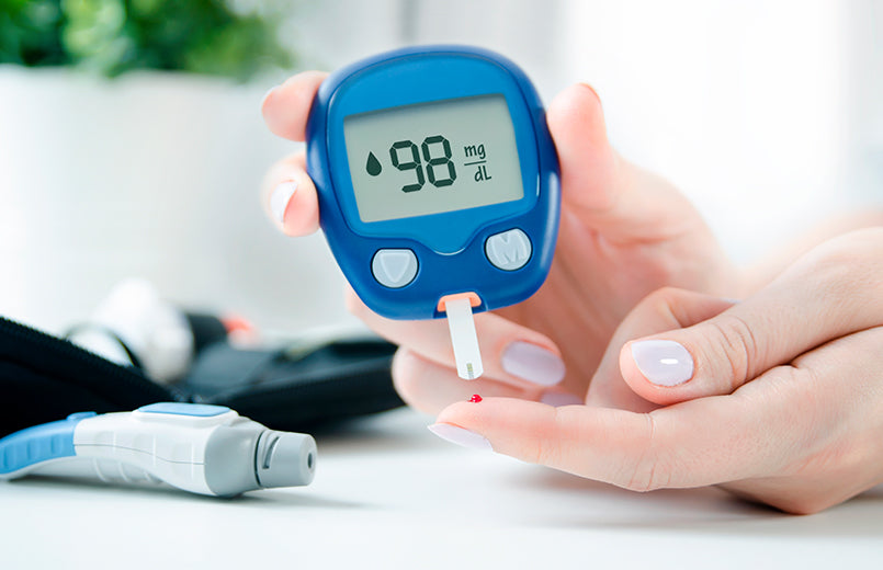 woman-using-lancelet-and-glucometer-at-home-checking-blood-sugar-level