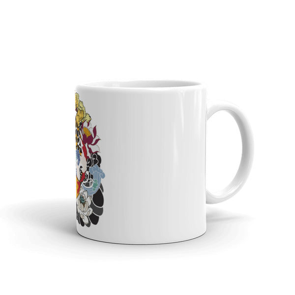 ceramic coffee mugs with print designs of fish over them