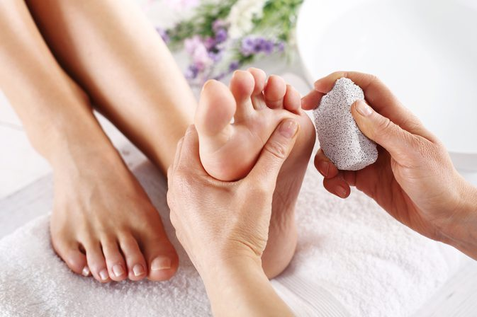 bare feet getting stone treatment