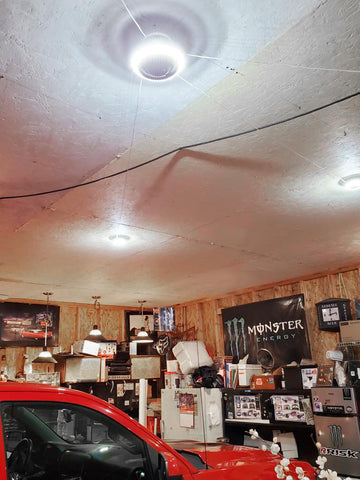 user garage with spectacular lighting mpi trilight motion deformable garage light