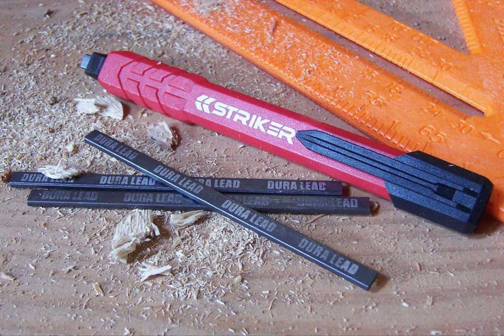 STKR Concpets striker mechanical pencil sitting on wood w 3 refills and speed square in pic