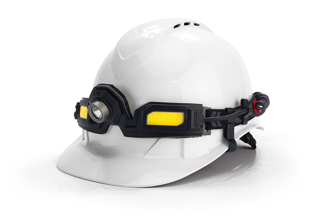 The Flexit Headlamp 6.5 on a white hard hat