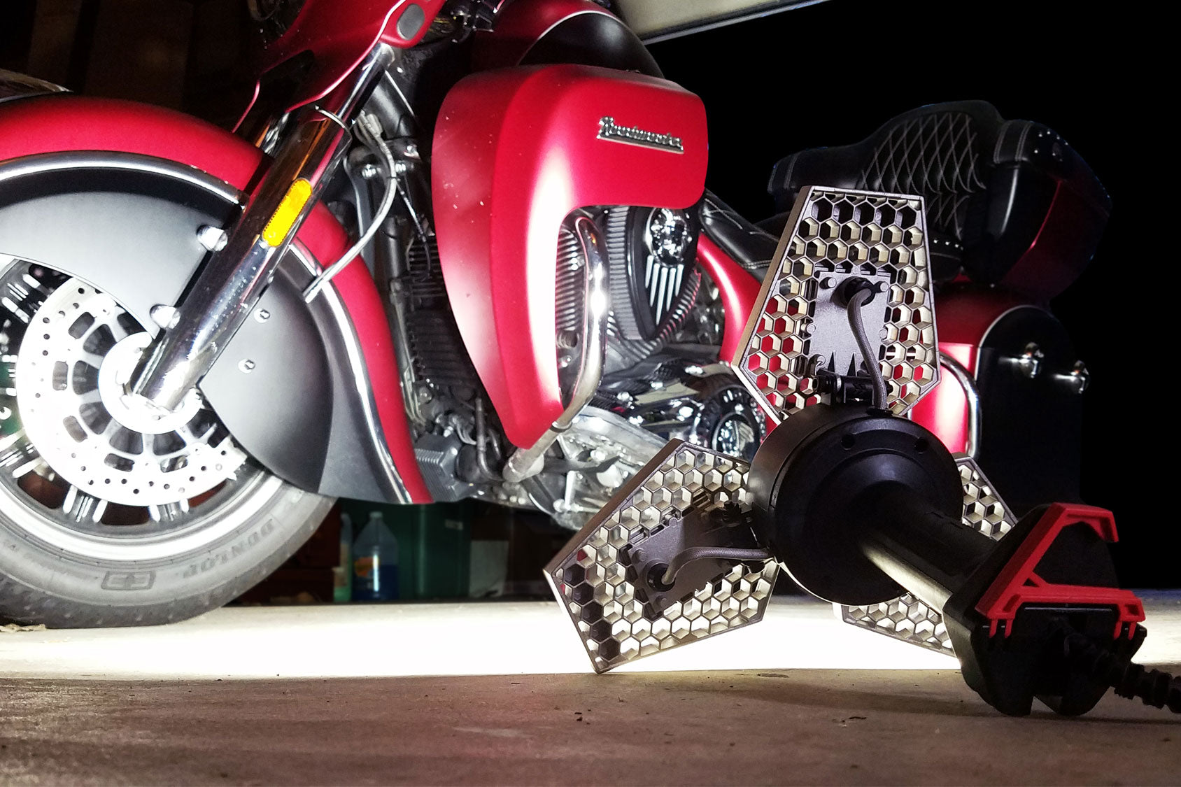 STKR Concepts TRiLIGHT ShopLight lighting up motorcycle