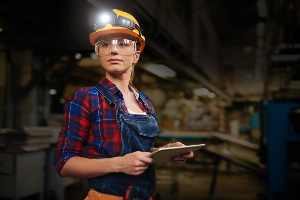 young woman wearing hard hat w flexit headlamp 2.5 by STKR Concepts