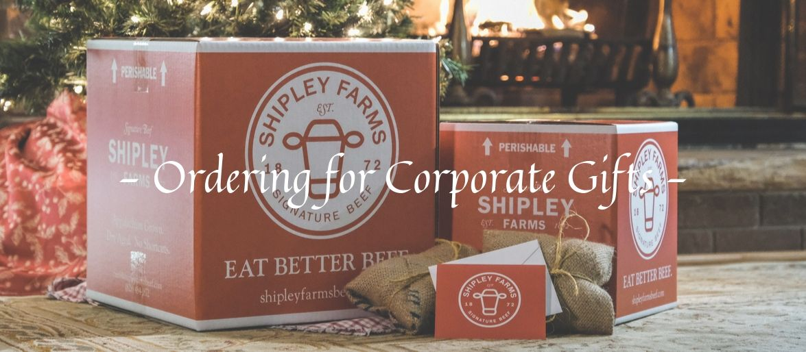 Ordering corporate gifts - shipley farms red boxes and packaging in front of a Christmas tree and fireplace