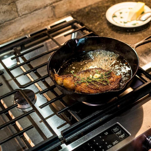 Shipley Farms steak cooking in stovetop skillet