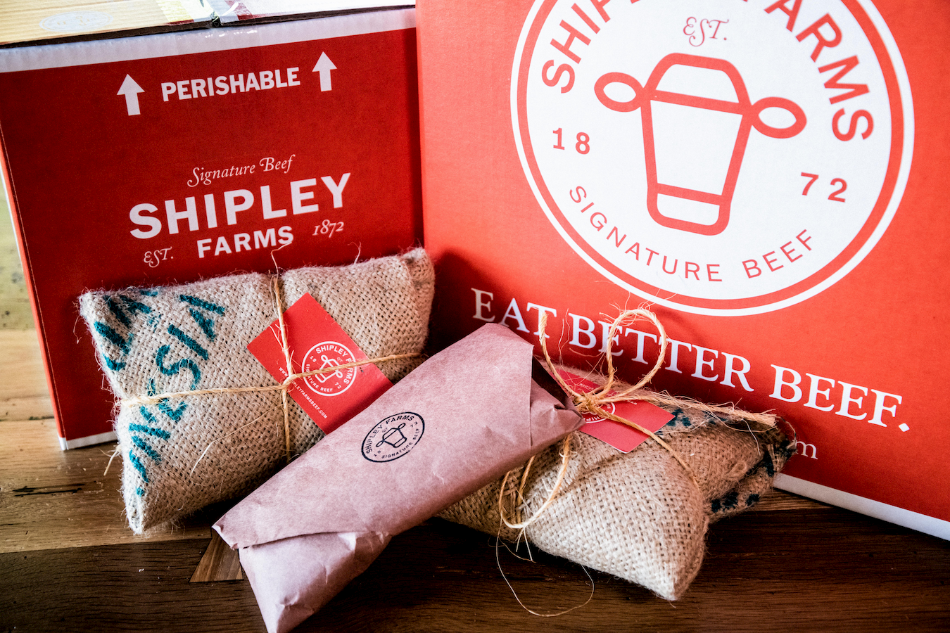 Shipley Farm's red packaging with logo and wrapped beef products